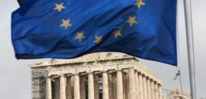 A European Union flag waves in front of the monument of Parthenon on Acropolis hill in Athens